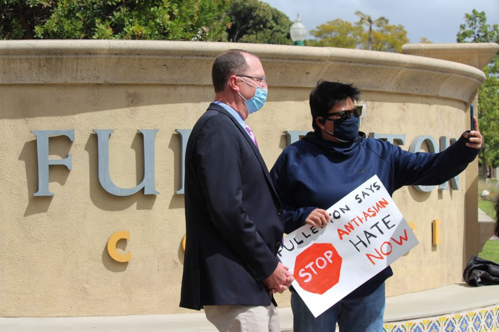 Fullerton College Student Senator Erin Lacorte taking a selfie with FC President Greg Schulz. President Schulz has previously approved of this demonstration and stood alongside other supporters rallying against anti-Asian hate.