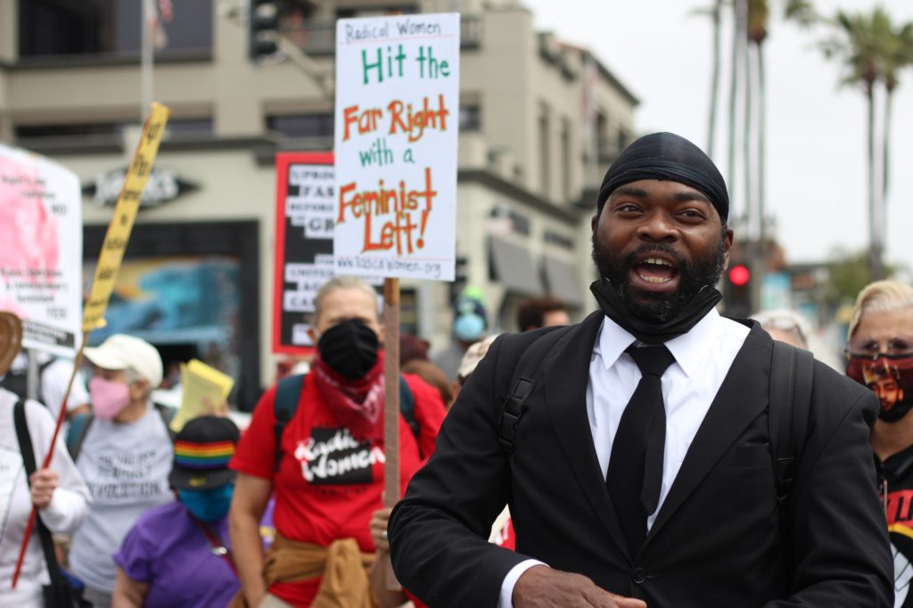 Tory Johnson led several chants at the start of the rally, creating crowds of supporters and onlookers. He noted several times that he does not want to be in the spotlight—he only wants to shine light on the issue as founder of the Black Lives Matter Huntington Beach chapter.