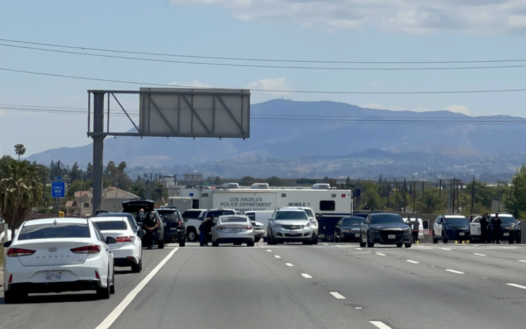 Los Angeles Police Department Command Center and other law enforcement vehicles during an active police-involved shooting on the 91 freeway westbound.