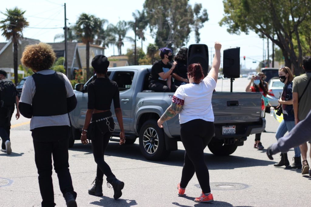 There were alleged officials helping in the march, including security and medics. The sister of David Sullivan, Sam, sat in the back of a truck leading the march and chants.