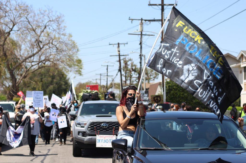About 50 people protested in the march, walking and driving through neighborhoods and city streets bringing attention to the issue as Buena Park residents watched from their properties.