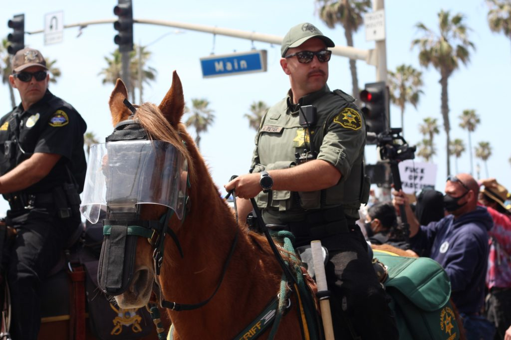 The Orange County Sheriff's Department was one of several agencies that were helping control the rallies. Others include the Seal Beach Police Department and the Anaheim police Department.