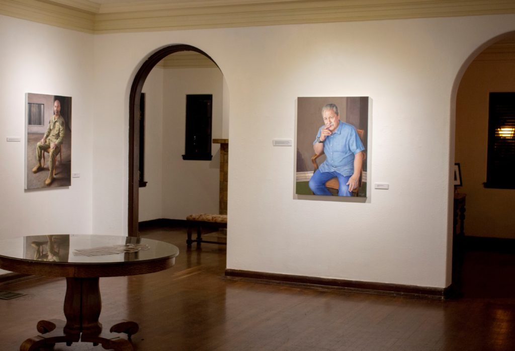 Portraits of Cástulo de la Rocha and military man Tim Sanchez hang in one of the many rooms at the Muck.