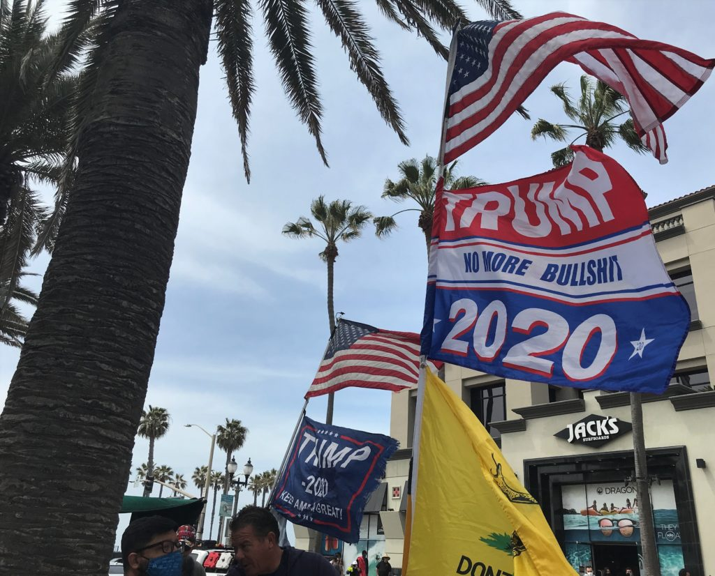 Two men arrived nearly two hours after the start of the BLM protest and carried Trump flags just a block from the pier on Main Street.
