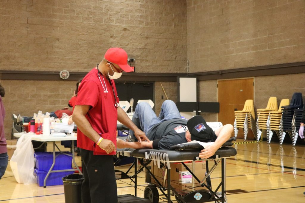American Red Cross staff David Person talks to a donor at the Love Fullerton blood drive.