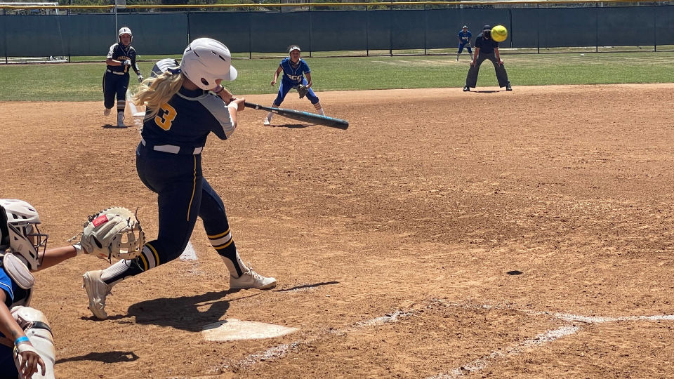Fullerton College's Madison Pevehouse, hits a double to right-center, allowing Emily Muro and Miranda Rooney to score off of the RBI.