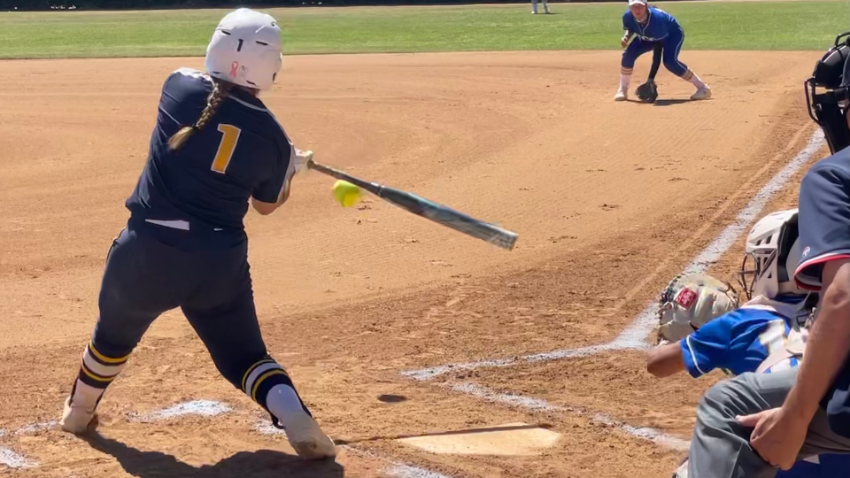 Hornet Dee Ramirez, with a .500 batting average, is a offensive and defensive powerhouse, shown hitting a ball during a doubleheader with Santiago Canyon College on April 30.