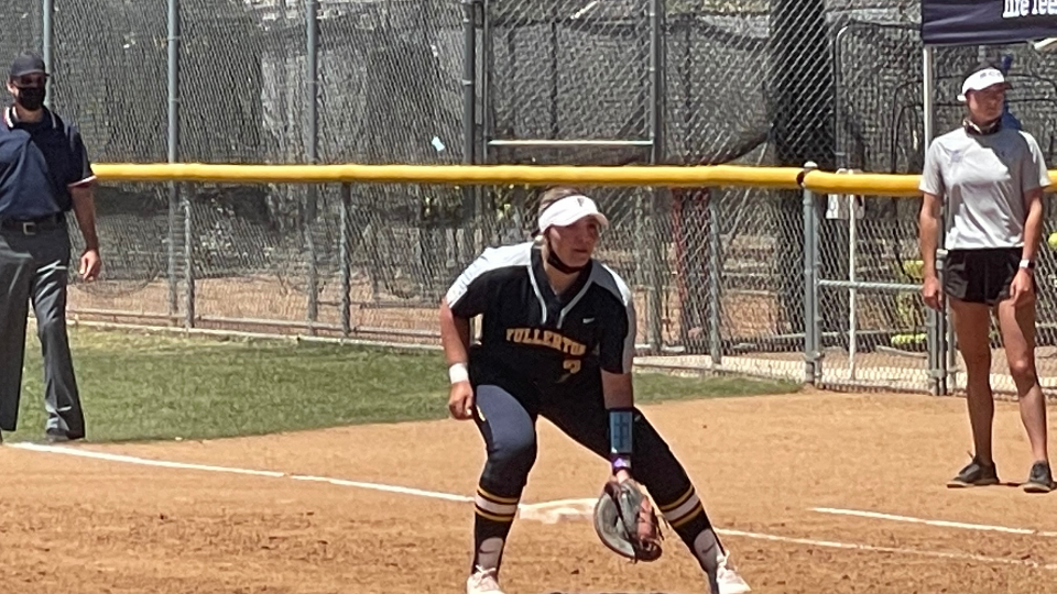 Fullerton College student-athlete Madison Pevehouse covers first base in a doubleheader April 30.