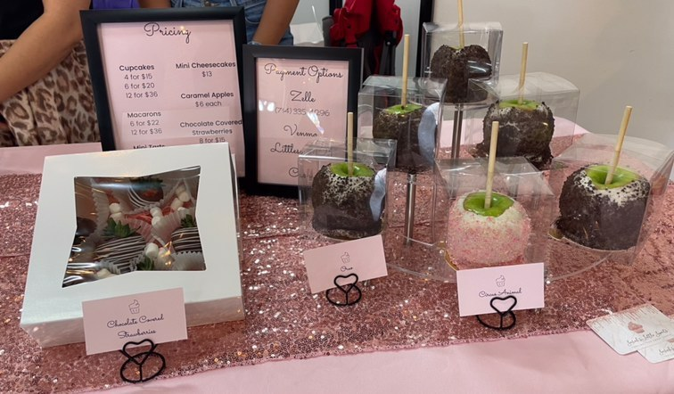 Different flavors of caramel apple and chocolate-covered strawberries sold by Little Sweets at the Sunshine Handmade Market in Downtown Fullerton.