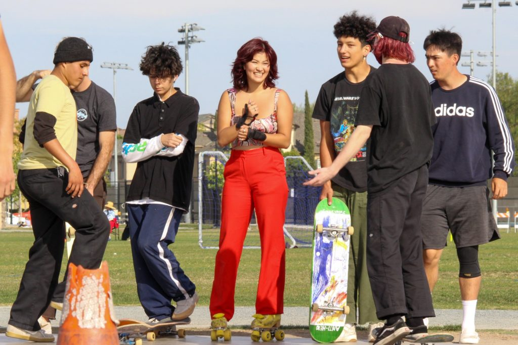 "The victim of the Tustin hate-crime, Jenna Dupuy (center), returned to the skate park for the first time Saturday, the same day the ""Skate to End Hate"" event was held."