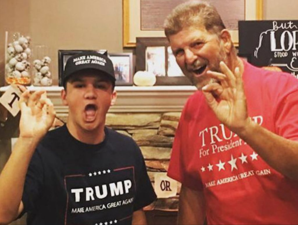 Braden Ellis (left) and his father flashing what appears to be the white power symbol