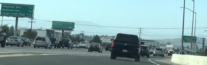 A caravan of FPD vehicles pursuing two suspects on the 57-freeway northbound.