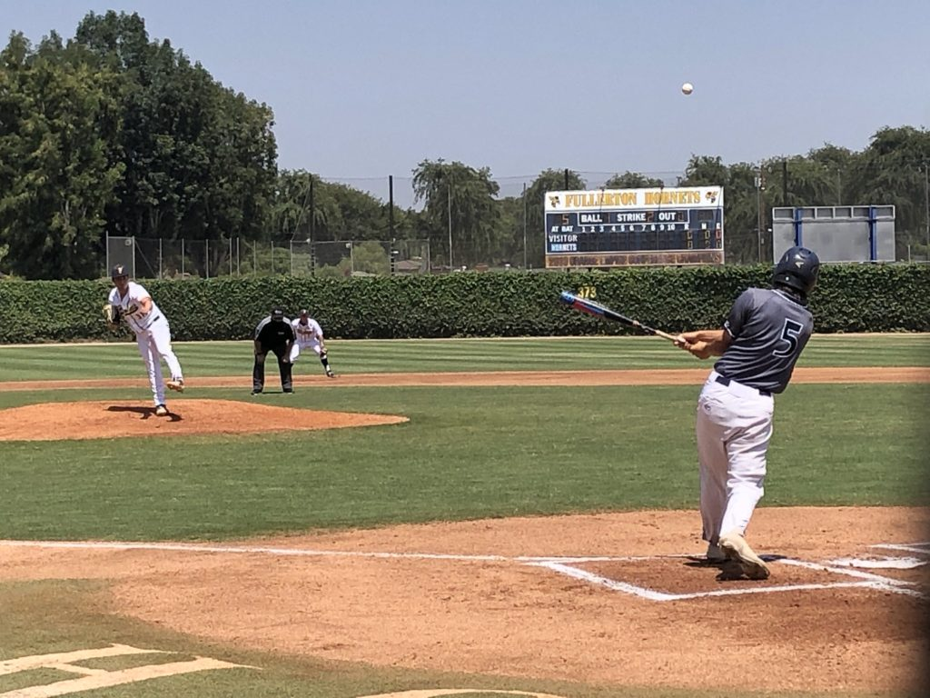 Cypress College outfielder Ricky Lane singles to right field off pitcher David Shlomovits