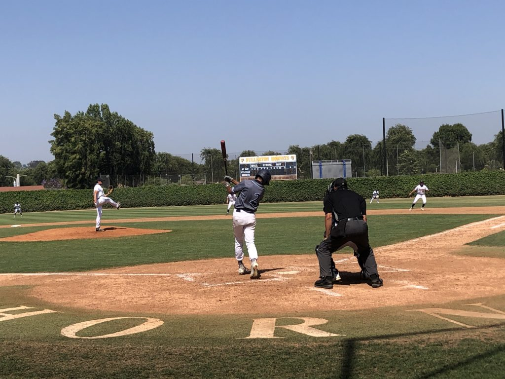 Hornets pitcher Bryce Barnett striking out Cypress college batter David Canales.