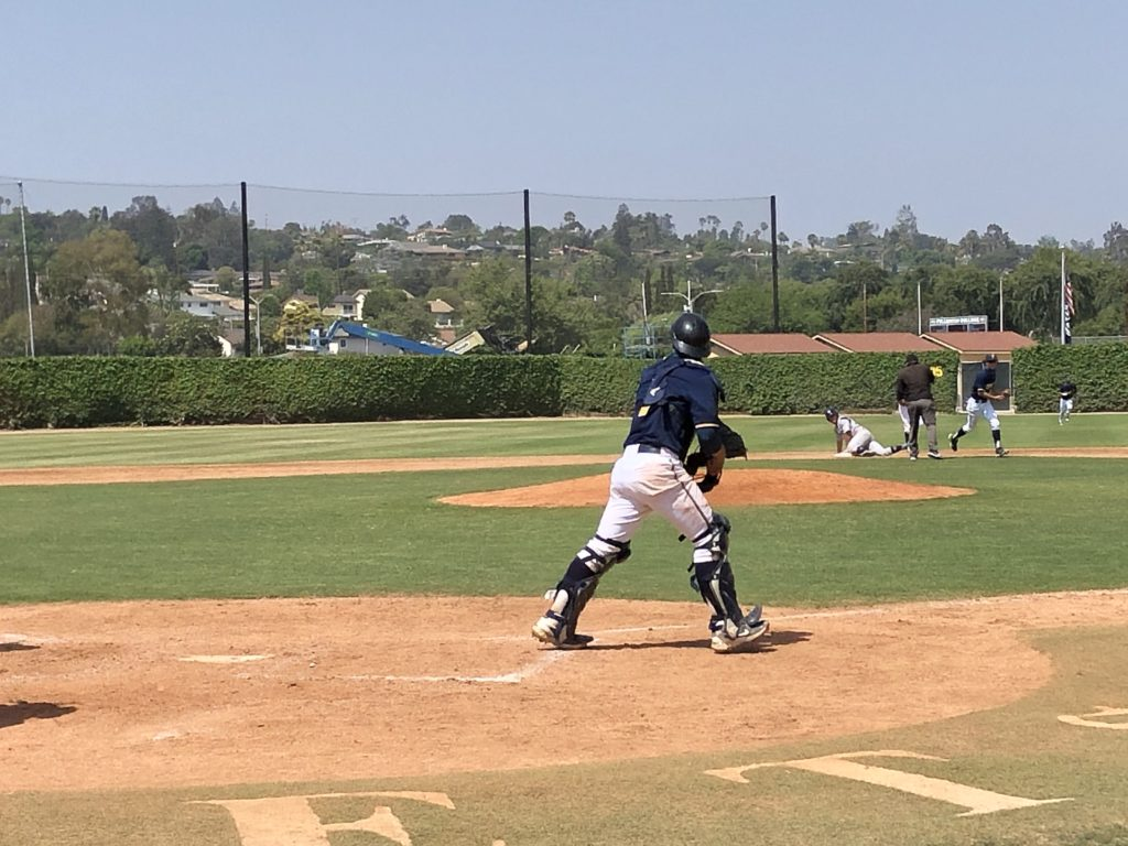 Hornets catcher Jacob Sharp throws out runner attempting to steal