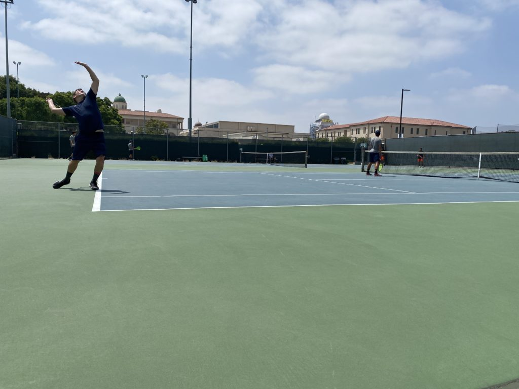 Scott Merritt gets ready to serve during his doubles match.