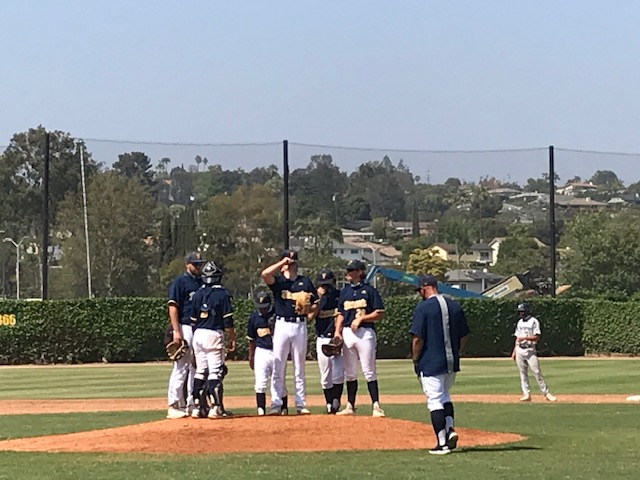Coach Baum went out to the mound a few times throughout the afternoon to calm his defense and make sure the team was on the same page.