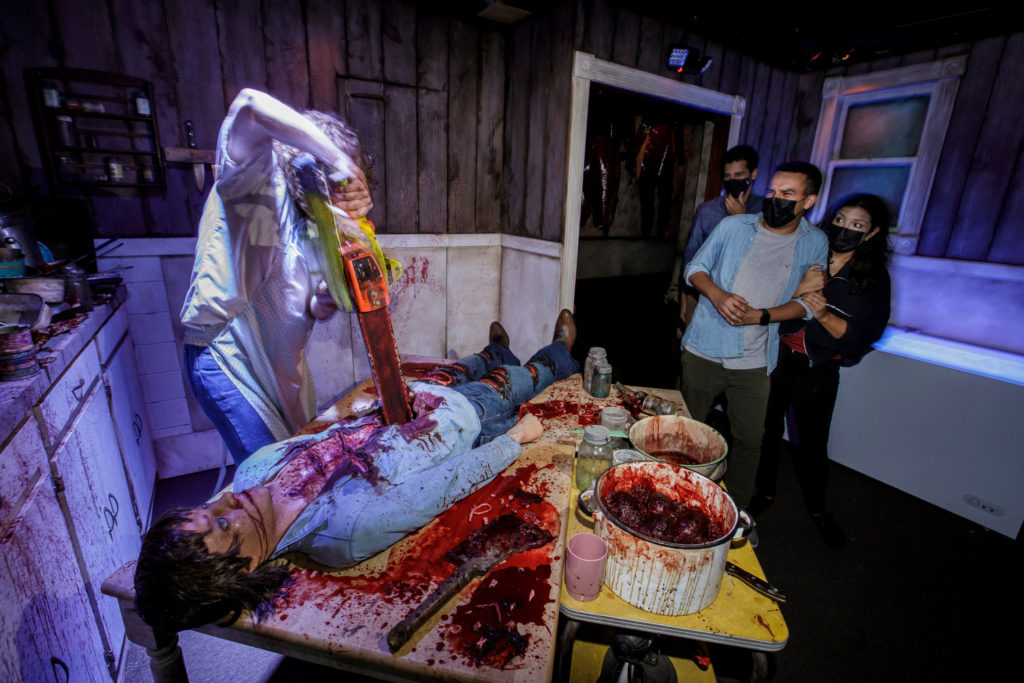Perhaps the next victims of Leatherface walk past a horrific scene at the Texas Chainsaw Massacre Maze.