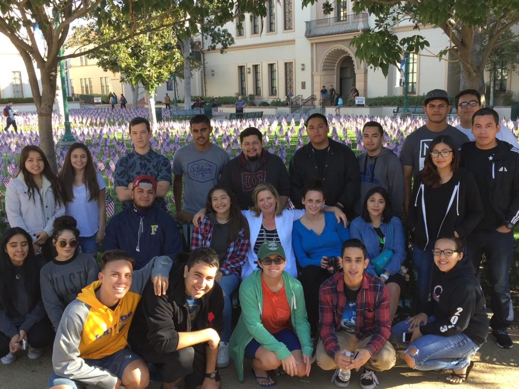 Administration of Justice Professor Kelly Robertson pictured in center-middle with students