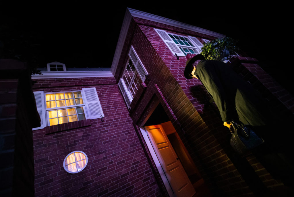 Exterior of The Exorcist maze showing the priest from the film looking into the house.