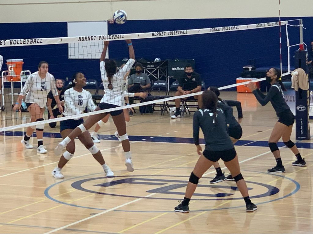 Freshman Alicia Isa Domingo (in the air), sets up the ball for Jade McIntyre(in front of Domingo) to spike the ball to Rio Hondo. Photo credit: Corinna Ortega