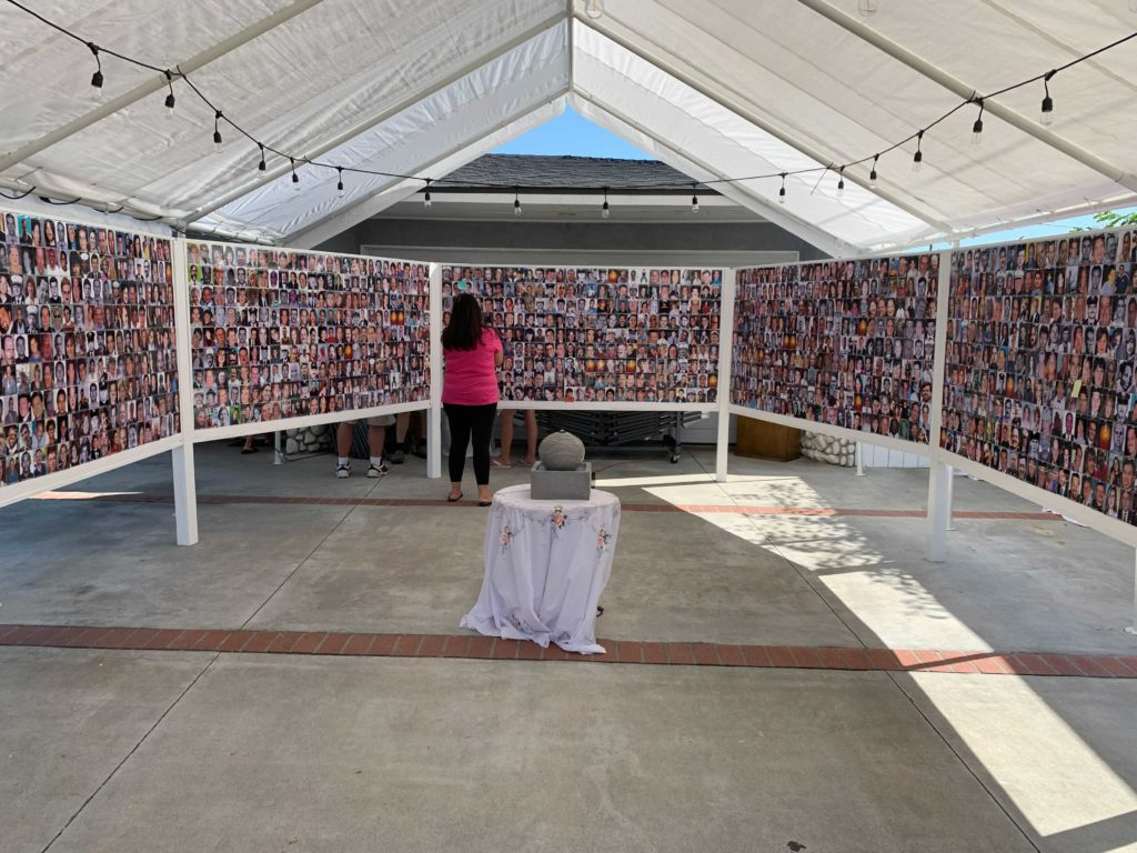 A broad picture filled walkway shows the many faces of the victims of 9/11.