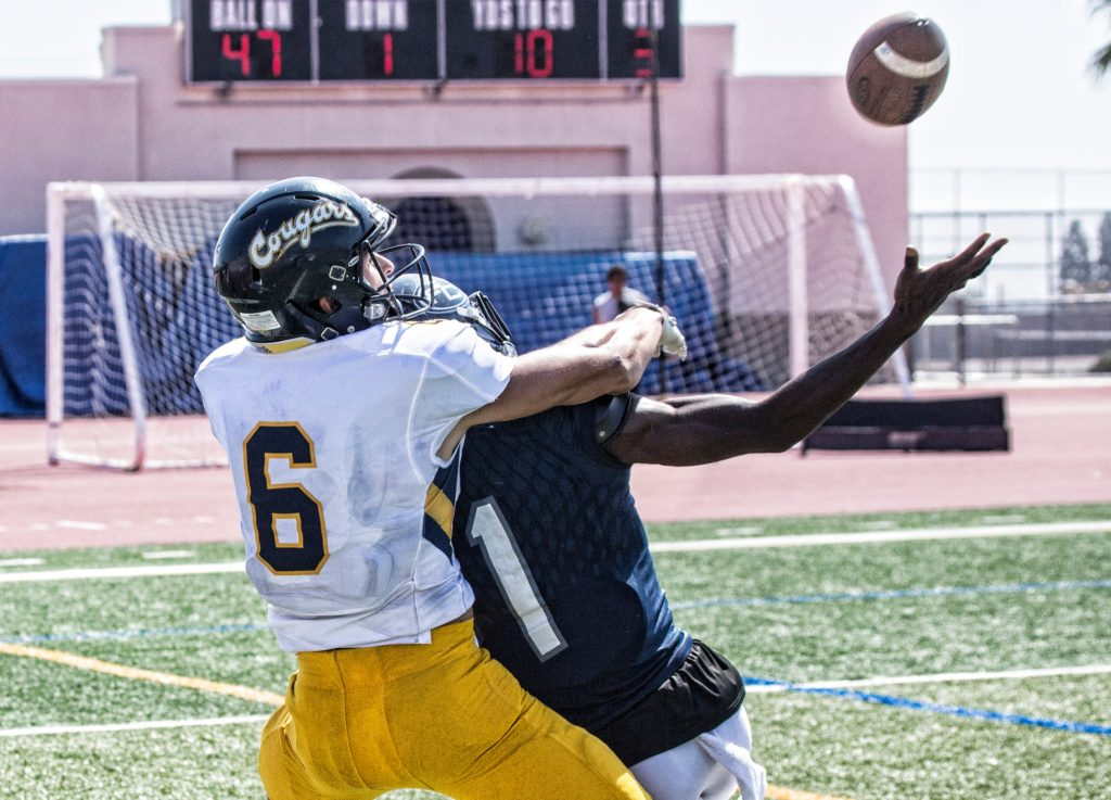 Freshman defensive back Elija Griffin defends over wide receiver as ball comes down. Photo credit: Jim McCormack