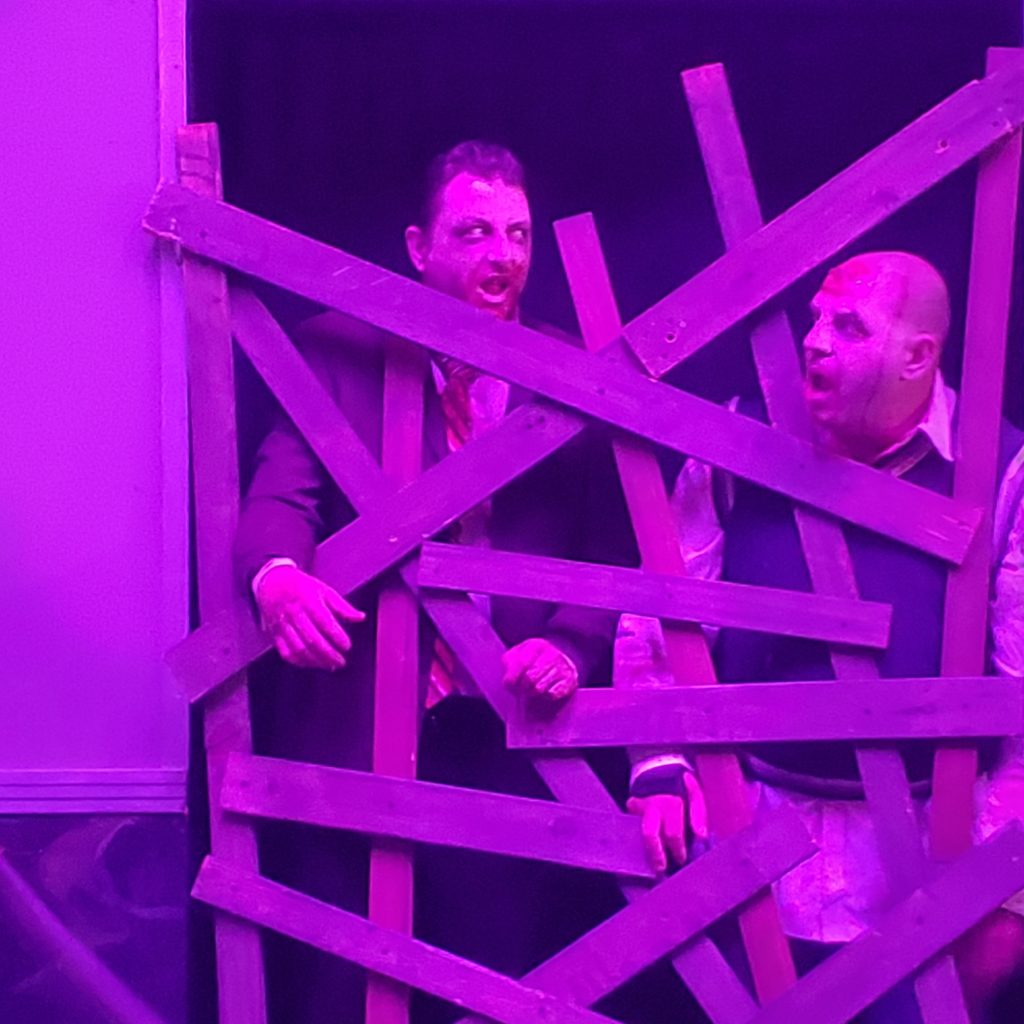 Zombies stare down guests as they try to break through a nailed wood opening. Photo Credit: Ethan Ahoia