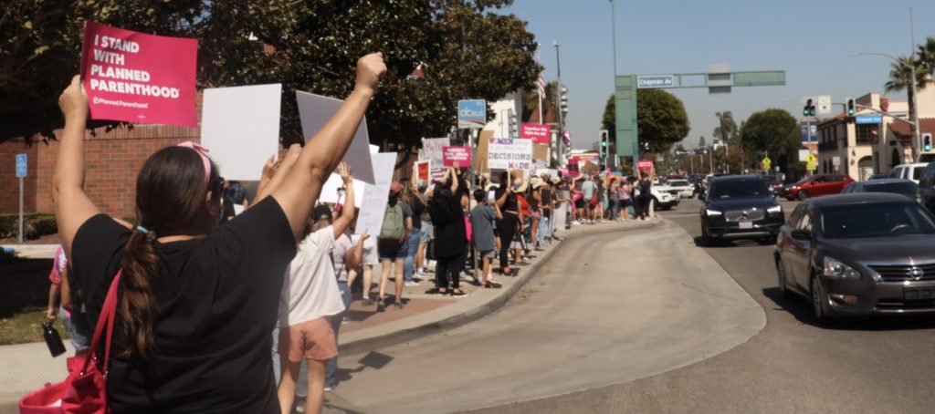 The streets of Downtown Fullerton were crowded with Women's March protesters between 11 a.m. and 12:30 p.m. Several cars passing by honked in support of the pro-abortion protest.