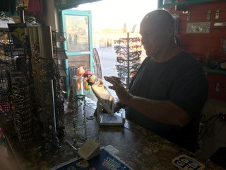 Dave Wiggins works in a store along the HB pier saw a significant decline the first day of the spill.